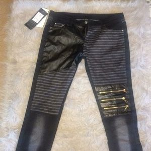 Fun Black and Pho leather pants with gold zippers.